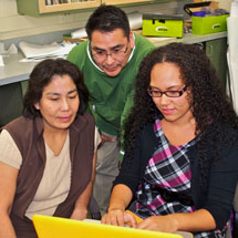 Students and Teachers Working On a Laptop